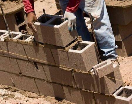 дом из керамзитобетонных блоков в пол блока фото